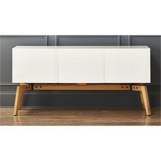 Shop alba credenza.   Clean white horizontal span facets topographic interest in design by Jannis Ellenberger.  Versatile storage shows its many sides for dining, media, bedroom, entry.