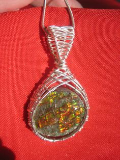 Wire-wrapped Ammolite.
