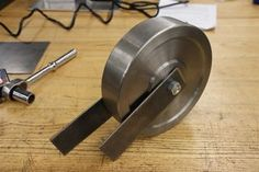 An english wheel is a classic hand-powered shop tool for making two-dimensional curves in sheet metal. Its used for making aircraft skins, car body parts,...