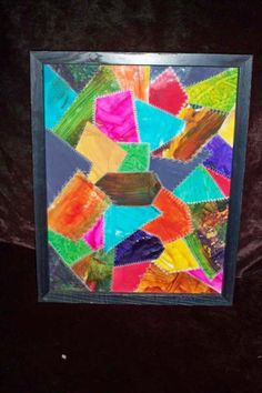 My kids art work turned into a stitched crazy quilt art piece.