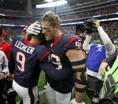 Houston Texans defensive end J.J. Watt (99) hugs punter Shane Lechler (9) 8cd3ab225