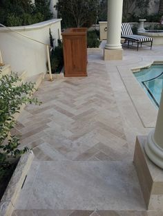 Peruvian Travertine in Herringbone pattern.