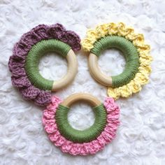 Spring has sprung! Choose one or all three of these adorable flower teethers! Each 2.5inch organic maple teething ring is crocheted over with 100% cotton yarn. Your baby will love to explore the different colors and textures of these unique teething toys!