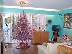 Wow — two stunning and unique vintage aluminum trees living under one roof — it must be a Christmas miracle. Description from retrorenovation.com. I searched for this on bing.com/images