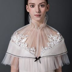 Details of the gorgeous Annabel wearing a piece from the 2016 Paris Couture collection. Foto Melody Lieftink. Hair and Make-up Lydia le Loux. #couture #custom #designer #fashion #runway #lace #embroidery #handcrafted #silk #sleek #jacket #dress #amsterdam #paris #edwinoudshoorn #work #love #white #weddinginspiration #bride #bridal #newlook #wool #3Dprint #flower #pleating #tule #white #sailor