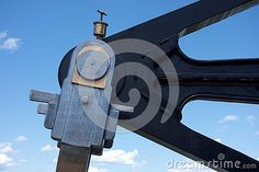 Photo about This is a close up detail of one side of a walking beam engine used to power old steam boats at the turn of the twentieth century. Image of close, mechanics, walking - 74139233 Steam Boats, Steam Engine, Beams, The Twenties, Close Up, Engineering, Ships, Walking, Industrial