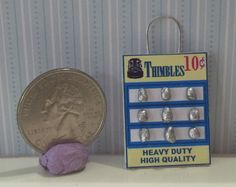 www.DollysGallery.com  Dollhouse Miniature Hanging Thimble Display Card. 1:12  This looks great hanging in a mini sewing room or a mini general store. This comes with 9 tiny thimbles! Dolly's Gallery is also on Ebay & Etsy. DollysGalleryMinis can be found on FB also. Lots of fun & unique Dollhouse House Miniatures!