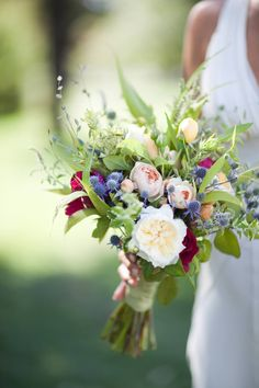 Wild flowers, greenery mixed with more formal flowers