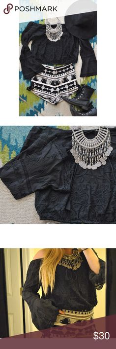 Off the Shoulder Bell Sleeve Bohemian Top 🌻 This free people adjustable off the shoulder, bell sleeve, flower/tribal embroidery, top is perfect with high waisted shorts/skirts! This shirt paired with ecote shorts (also listed) is a festival chic match made in heaven 🙌🏼✨ I've only worn the top once, so its practically new! I'm willing to negotiate! You can make offers and I can create bundle deals too! (This Top can fit either a small or medium) Free People Tops Tees - Long Sleeve