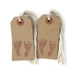 """Kraft paper tags size 3 1/4"""" x 1 5/8"""" with baby footprints. Includes 12 tags with attached strings. Reinforced 1/4"""" paper eyelet that resists tearing. Use as gift tags, to tie up baby shower favor tag"""