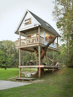 I'd love to build something like this around our hollow tree stump! Impressive Tiny Houses - Small House Plans - Country Living