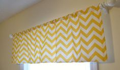 Yellow Chevron curtains {as a valance over a white shower curtain liner, tied to the shower curtain hooks with black ribbons}