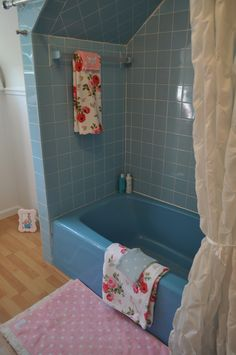 My Cath Kidstoned up guest bathroom! haha.  Had to make old retro blue bath tiles work somehow and this seemed like the only solution. Antique Rose Cath Kidston Wallpaper, Cath Kidston bath towels pink dot & blue dot. Retro Girly Vintage Fun 50s style bathroom. Hilda Pinup