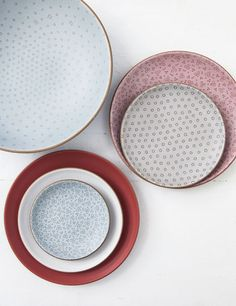 "Dinnerware: Each bowl, cup, and plate from the showstopping Alabama Chanin for Heath Ceramics collection is hand-etched in one of three patterns inspired by the stitching of Natalie Chanin's clothing line, and they're as hardworking as they are decorative. ""I adore the big serving bowl,"" says the Florence-based designer. ""I make my biscuits in it."" Pair with a linen runner for a dinner-party-ready table ( heathceramics.com). Photo Credit: Andrew Cebulka"
