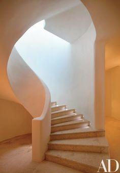This beautiful tropical villa was designed by Javier Barba in 2002 on the island of Mykonos, Greece. Mykonos is among the most fabled of all the Greek isles, slap in the middle of the Aegean. Curved Staircase, Staircase Design, Spiral Staircases, Interior Stairs, Interior Architecture, Vernacular Architecture, Architectural Digest, Mykonos Villas, Mykonos Greece