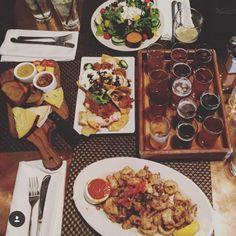 Flight of beers, Greek salad, cheese board, calamari, & pulled pork nachos