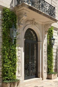 Carved Limestone surround and wrought iron door and balcony of door to Crespi Hicks Estate in Dallas
