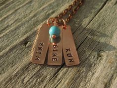 Swim, Bike, Run Hand Stamped Triathlon Necklace In Copper with Wire Wrapped Turquoise Bead