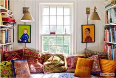 The window seat in our kitchen. All pillows handknit, handmade from molas, or embroidered.