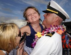 PEARL HARBOR (June 29, 2011) Lt. Donald Curran, chief staff officer aboard the guided-missile destroyer USS Paul Hamilton (DDG 60), is greeted by his family after returning from a seven-month deployment.(U.S. Navy photo by Mass Communication Specialist Seaman Sean Furey/Released)