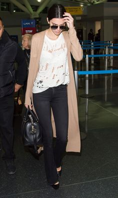 fashion-2016-03-kendall-jenner-ripped-white-t-shirt-with-holes-main.jpg (1500×2505)
