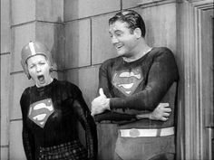 I Love Lucy show..... Lucy & Superman on the ledge of the apartment in the rain....Lucy is going to pose as Superman when the real one shows up.