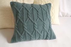 This blue spruce pillow cover has a cable stitch design on front as well on back.  To close the pillow I used my signature envelope style and three