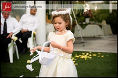 Such an adorable flower girl and Ashley and Sean's wedding at Mixon Fruit Farm