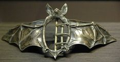 Belt Buckle in the Form of a Bat. Designed by Ferdinand Erhart (fl. 1891-1933). Model created in 1908. Cast silver, carved and oxidized. Collection Musée d'Orsay, Paris [OAO 1336]. Gift of the Friends of the Museum in 1997.  Photograph by George P. Landow