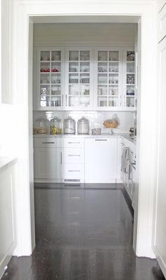 kitchen- open pantry white cabinetry glass fronted upper cabinets carrara marble countertops nickel hardware dark hardwood floors cannisters tiled backsplash (for my baking!)