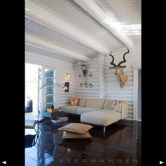 Painted log walls look modern  less rusticLog walls painted white for a more formal feeling    Colors and   of Painting Log Cabin Interior Walls