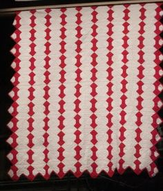 Selvage Blog: Red and White Pieced Quilts, Bow Tie quilt, interesting layout. Zig zag outer edge.