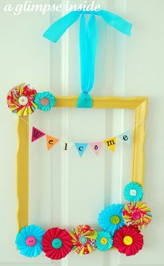 Summer frame wreath – I love all these bright colors.  You'll never believe the before and after from this thrift store find!