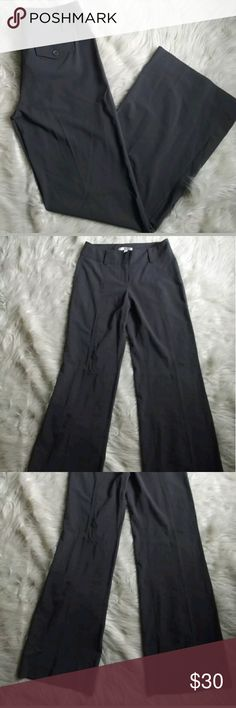 cAbi Gray Stretch Trouser Style Dress Pants Sz 4 cAbi Gray Stretch Flare Leg Trouser Style Dress Pants Womens Size 4 Career?  Perfect for the office. Very stretchy and the fit is amazing.?60%polyester 35% viscose 5 % spandex  Machine wash cold. Can be dry cleaned. Flare leg opening trouser style pants. No flaws. Has 2 functional back pockets.?Zipper opening?buttons tab closure and belt loops.  Measurements Flat:  Waist: 33 inches  Rise: 10 inches  Inseam: 36.5 inches CAbi Pants