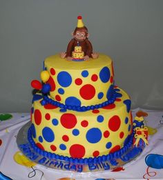Curious George cake, only without the blue. white instead! and darker yellow.