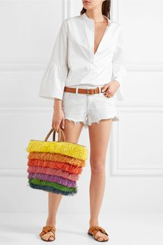 Multicolored straw, tan leather Drawstring top  Weighs approximately 1.8lbs/ 0.8kg