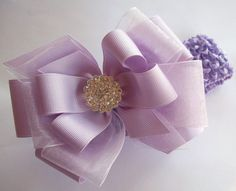 Dressy lavender Boutique Hair Bow.  Fits All ages...