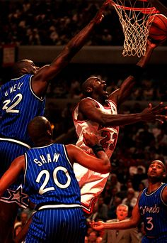 Michael Jordan shoots over Shaquille O'Neal