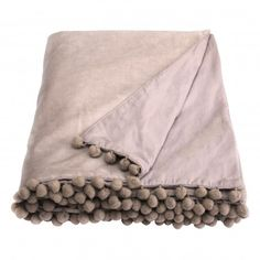 This stunning Belinda Taupe (Beige) Velvet Throw is made from a 100% cotton luxurious velvet. It's so sophisticated with its pretty pom pom trim, it'll definitely bring a touch of glamour to any bedroom, lounge or boudoir. - 100% cotton velvet face - Lined with 100% cotton poplin on the reverse - Cotton pom pom trim on two sides - Size 140cm x 180cm - Dry clean only due to velvet pile - Matching items available