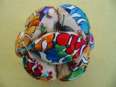 Tutorial forCloth ball that is easy for a baby to hold. This could be made of scraps but looks better in just 2 colours ( fabrics ). The fi...