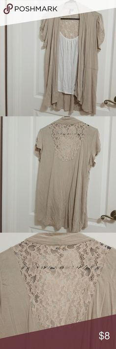 Beige Heartsoul Blouse This shirt doesn't have the tags but it's never been worn, other than to try on.  It looks as if it's 2 pieces but they are connected, so it's just one shirt.  96% Rayon, 4% spandex. HeartSoul Tops Blouses