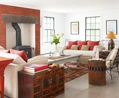 Red is a powerful color so if you want to incorporate it into a room of the house it should be the living room. Red living room designs are always vibrant Living Room Photos, Living Room Red, Living Spaces, Red Brick Fireplaces, Fireplace Hearth, Stove Fireplace, Window Furniture, Outdoor Furniture Sets, Furniture Placement