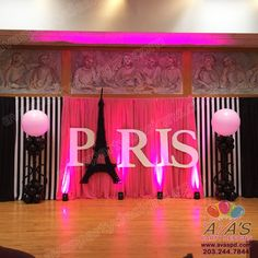 Paris themed Balloon Decor and Fabric Backdrop. Large Paris Letting Eiffel Tower Balloon Sculpture and custom detail balloon columns. #Partywithballoons #avaspartyrentals