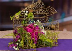 Birdcage filled with florals