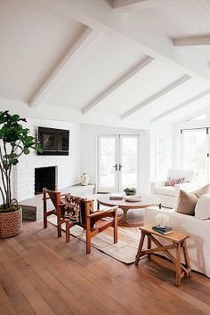 COCOCOZY painted wood ceilings create a monochromatic palette for this Great Room.