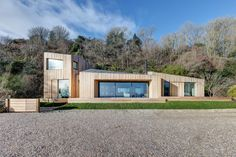 This holiday home on the West Dorset coast is made up of four larch-clad blocks, designed byAR Design Studio to replace a house destroyed in a landslide.