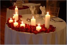 We discused something simple for the Sweetheart table - perhaps rose petals surrounding and different heights of floating candles (lower in the front as to not block your faces). Romantic Dinner Setting, Romantic Dinners, Romantic Mood, Romantic Evening, Winter Wedding Decorations, Wedding Centerpieces, Table Decorations, Decor Wedding, Wedding Ideas