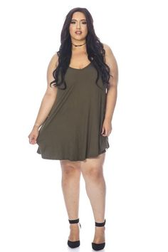 Plus size solid spaghetti strap shift dress made of peach skin soft fabric. Affordable junior and plus size clothing.
