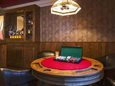 The Speakeasy Suite at New York City's Carlton Hotel pays tribute to the city's Prohibition days with a secret back room attached to the bedroom that is only accessible through a hidden door masquerading as a bookcase. Once inside, the cozy bonus room offers a plethora of forbidden treasures, including a (non-working) tommy gun, custom-designed poker table with cards and chips, period photography and New York Times front pages, and a well-stocked private bar with leather furniture for…