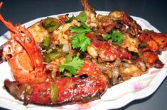 Default - One of the most popular authentic chinese dishes. This quick and easy 2 step dish starts with a 4 lb live lobster cut into pieces, starch dusted, and deep fried for 1 minute, then stir fried in black bean sauce. Lobster Cantonese Recipe, Lobster Recipes, Seafood Recipes, Fried Lobster, Cantonese Cuisine, How To Cook Liver, Live Lobster, Best Dishes, Seafood